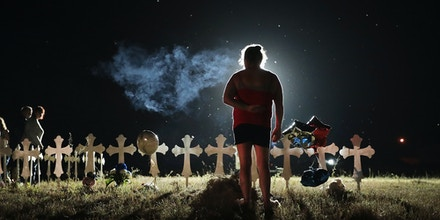 SUTHERLAND SPRINGS, TX - NOVEMBER 06:  Twenty-six crosses stand in a field on the edge of town to honor the 26 victims killed at the First Baptist Church of Sutherland Springs on November 6, 2017 in Sutherland Springs, Texas. Yesterday a gunman, Devin Patrick Kelley, shot and killed the 26 people and wounded 20 others when he opened fire during a Sunday service.  (Photo by Scott Olson/Getty Images)