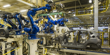 Robotics arms are seen at the recently opened Honda Motors factory in Celaya, Guanajuato state, Mexico, on February 21, 2014. AFP PHOTO/OMAR TORRES / AFP        (Photo credit should read /AFP/Getty Images)