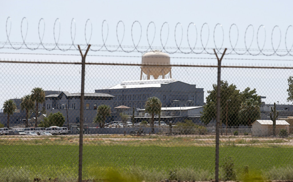 FILE - In this July 23, 2014, file photo, a fence surrounds the state prison in Florence, Ariz., where the execution of Joseph Rudolph Wood took place. One of two lawsuits against the state of Arizona over the secrecy around executions will get its day in court on Friday, Oct. 28, 2016, as attorneys present oral arguments. The lawsuit was filed by a coalition of news organizations including The Associated Press after the July 2014 execution of Wood, who died nearly two hours after he was injected with a two-drug combination. (AP Photo/File)