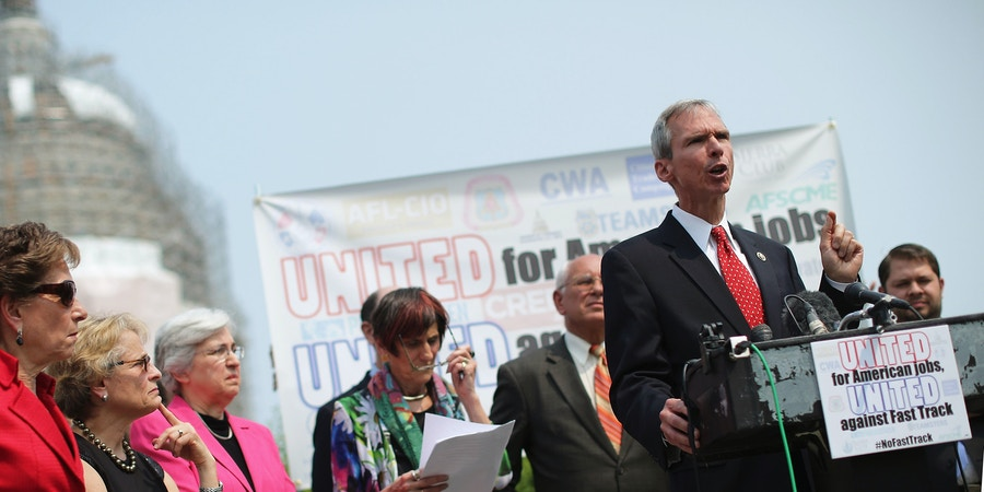 WASHINGTON, DC - JUNE 10:  Rep. Dan Lipinski (D-IL) (2nd R) and fellow Democratic members of Congress hold a news conference to voice their opposition to the Trans-Pacific Partnership trade deal at the U.S. Capitol June 10, 2015 in Washington, DC.  The congressional Republican leadership announced that the House will vote Friday to approve the TPP and give President Barack Obama fast-track authority to negotiate a large-scale trade deal.  (Photo by Chip Somodevilla/Getty Images)