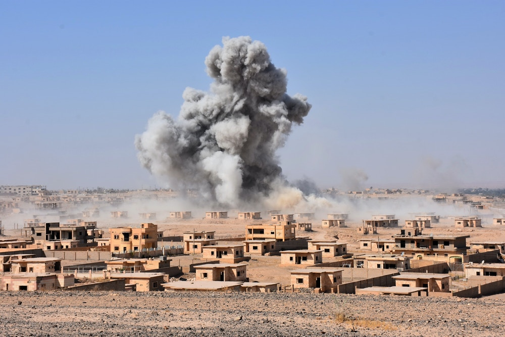 Smoke rises from buildings in the area of Bughayliyah, on the northern outskirts of Deir Ezzor on September 13, 2017, as Syrian forces advance during their ongoing battle against the Islamic State (IS) group. After breaking an Islamic State group blockade, Syria's army is seeking to encircle the remaining jihadist-held parts of Deir Ezzor city, a military source. / AFP PHOTO / George OURFALIAN (Photo credit should read GEORGE OURFALIAN/AFP/Getty Images)