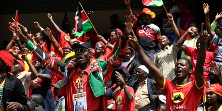 Supporters of the Jubilee Party celebrate during the inauguration ceremony of President Uhuru Kenyatta, during his inauguration ceremony at Kasarani Stadium on November 28, 2017 in Nairobi. President Uhuru Kenyatta vowed to be the leader of all Kenyans and work to unite the country after a bruising and drawn out election process that ended with his swearing-in. / AFP PHOTO / SIMON MAINA (Photo credit should read SIMON MAINA/AFP/Getty Images)