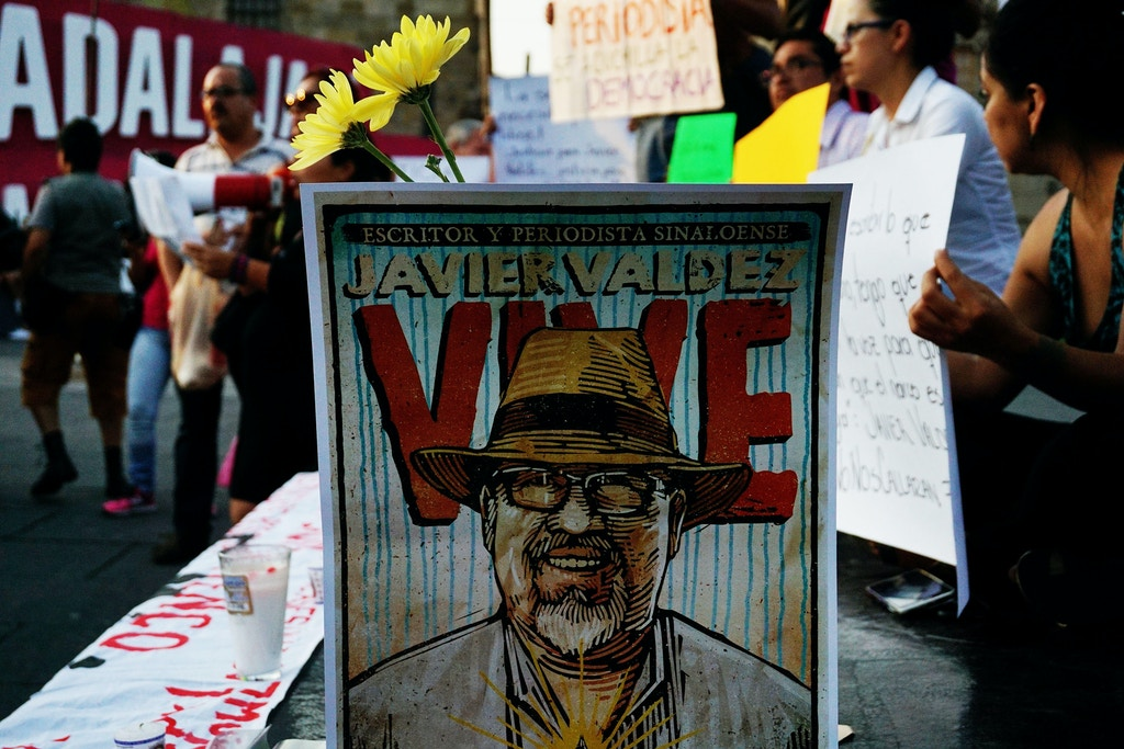 Journalists hold signs condemning violence against journalists while protesting the recent murder of the of Mexican journalist Javier Valdez on May 16, 2017 in Guadalajara. Mexico ranks third in the world for the number of journalists killed, after Syria and Afghanistan, according to the media rights group Reporters Without Borders (RSF) / AFP PHOTO / Hector Guerrero (Photo credit should read HECTOR GUERRERO/AFP/Getty Images)