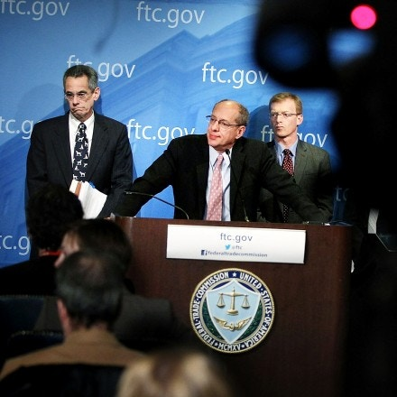 WASHINGTON, DC - JANUARY 03:  U.S. Federal Trade Commission Chairman Jon Leibowitz (2nd L) speaks as Bureau of Competition Director Richard Feinstein (L), and Bureau of Economics Director Howard Shelanski (R) listen during a news conference regarding the agency's 21-month-long investigation on Google January 3, 2013 at the FTC headquarters in Washington, DC. FTC announced that Google has agreed to change some of its business practices, including giving competitors access to standard-essential patents and letting advertisers to get more flexibility to use rival search engines, to resolve the agency's competition concerns in the markets for devices like smart phones, games and tablets and in online searching.  (Photo by Alex Wong/Getty Images)