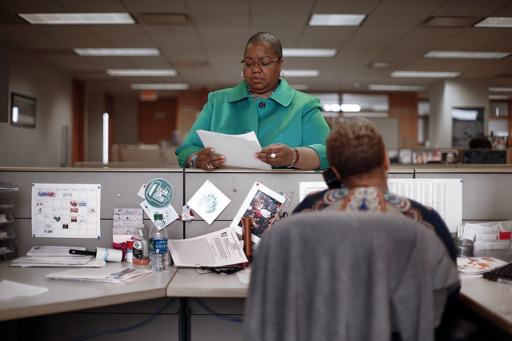 Wayne County Prosecutor Kym Worthy looks at documents in Detroit on Monday, April 20, 2015. Her office is working with the Michigan Women's Foundation and the Detroit Crime Commission to raise money to complete the backlog of rape kit testing and investigation and bring suspects to trial. (AP Photo/Paul Sancya)