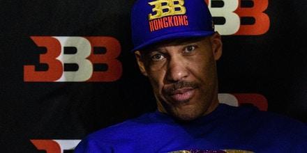 LaVar Ball (L), father of basketball player LiAngelo Ball and the owner of the Big Baller brand, attends a promotional event in Hong Kong on November 14, 2017.UCLA players LiAngelo Ball -- the younger brother of Los Angeles Lakers rookie star Lonzo Ball -- and teammates Cody Riley and Jalen Hill were arrested on November 7 in Hangzhou ahead of their regular-season-opening game against Georgia Tech in nearby Shanghai this past weekend. ESPN reported that they were nabbed on suspicion of stealing from a Louis Vuitton store and later freed on bail but ordered to remain in Hangzhou. / AFP PHOTO / Anthony WALLACE (Photo credit should read ANTHONY WALLACE/AFP/Getty Images)