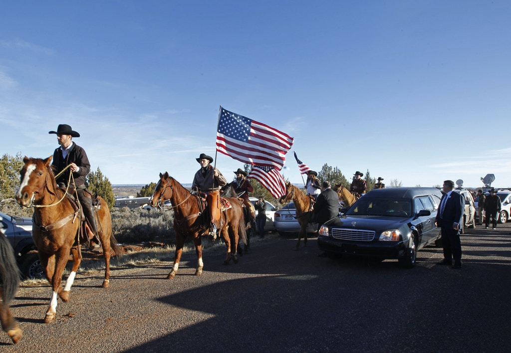 "KANAB, UT - FEBRUARY 5: People line the road as a horse honor guard escorts the hurst after the funeral of rancher Robert ""LaVoy"" Finicum on February 5, 2016 in Kanab, Utah. Finicum who was part of the Burns, Oregon standoff with federal officials was shot and killed by FBI agents when they tried to detain him at a traffic stop on February 27, 2016. ( Photo by George Frey/Getty Images"
