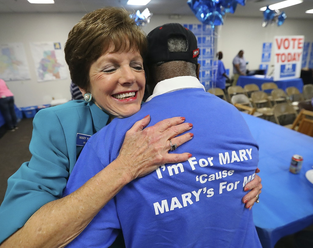 Mary Norwood, candidate for mayor, gives volunteer Jerome Whitaker a hug for his support at her headquarters Tuesday, Nov. 7, 2017, in Atlanta. (Curtis Compton/Atlanta Journal-Constitution via AP)
