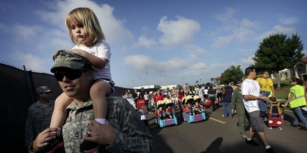 April 2, 2012 - Tampa, FL, USA - EDMUND D. FOUNTAIN  l  Times.TP_352320_FOUN_CHILD.(04/02/2012 Tampa) United States Army Sgt. 1st Class Donnie Terrell carries his daughter Hailey Terrell, 2, on his shoulders as they participate in a parade at MacDill Air Force Base to honor the children of service members. April is recognized as the Month of the Military Child. Terrell says that he has been stationed at MacDill for just over a year, and was stationed in Ft. Campbell, Kentucky, prior. He has been in the military for twenty years, and was to be promoted to Master Sgt. later in the day. (Credit Image: © Tampa Bay Times/ZUMAPRESS.com)