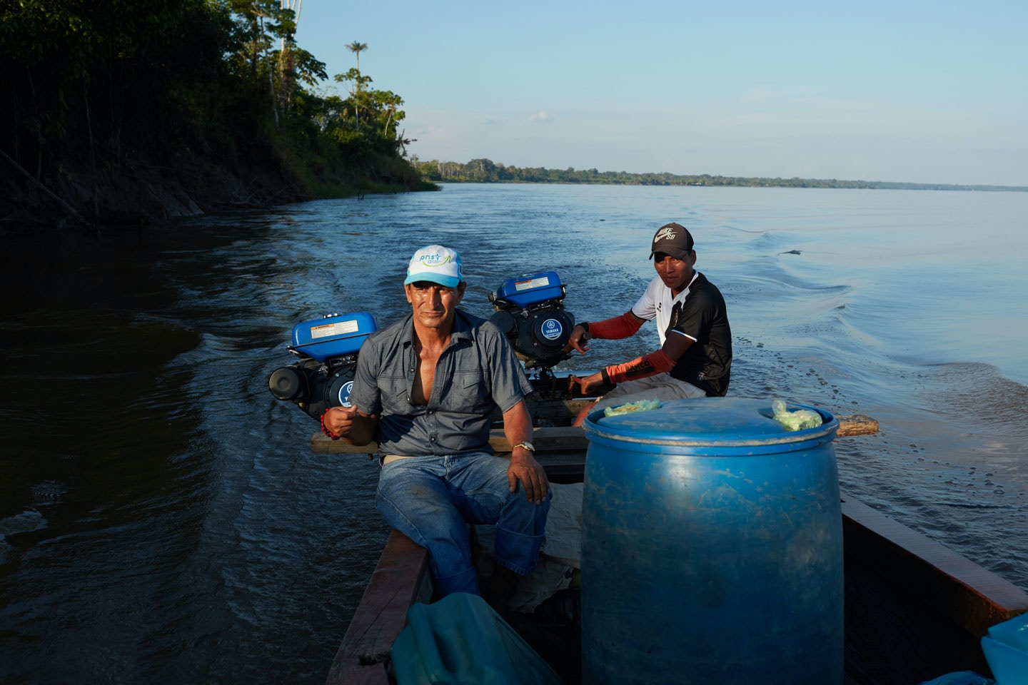 "DOS DE MAYO, PERU – JULY 16, 2017: Apu Alfonso Lopez Tejare, pilots a boat from Naulta to his home village of Dos de Mayo on the Marañón River in the State of Loreto, Puru. Alfonso Lopez Tejare is the leader of his community, he say's ""In October 2000, there was a great spill near Saramuro in the Marañón. A black stain covered the river all the way to Nauta, several hours by boat. The company hired us to collect the oil with sticks and mugs and bury it. They gave us no protection. Weeks later, flood season arrived. Our communities and farmlands were flooded with petroleum. The people dug holes and tried to bury it.Even then, we didn't know much about oil. We didn't understand when the media said it would take the heavy metals 30 years to settle in the bottom of the river. But we noticed the fish in the streams were becoming thin and malnourished. Their eggs were small. Before the spill, we would drop a net and catch half-a-ton of fish. After, we caught maybe 30 kilograms of sick fish. People began to be ill. Strange bumps and rashes. Children no longer learned well in school. They had stomachaches and headaches. The traditional medicines did not cure us. We went to the health centers in the cities, but there were no remedies."" July 16, 2017. (Photo by Ben Depp)"