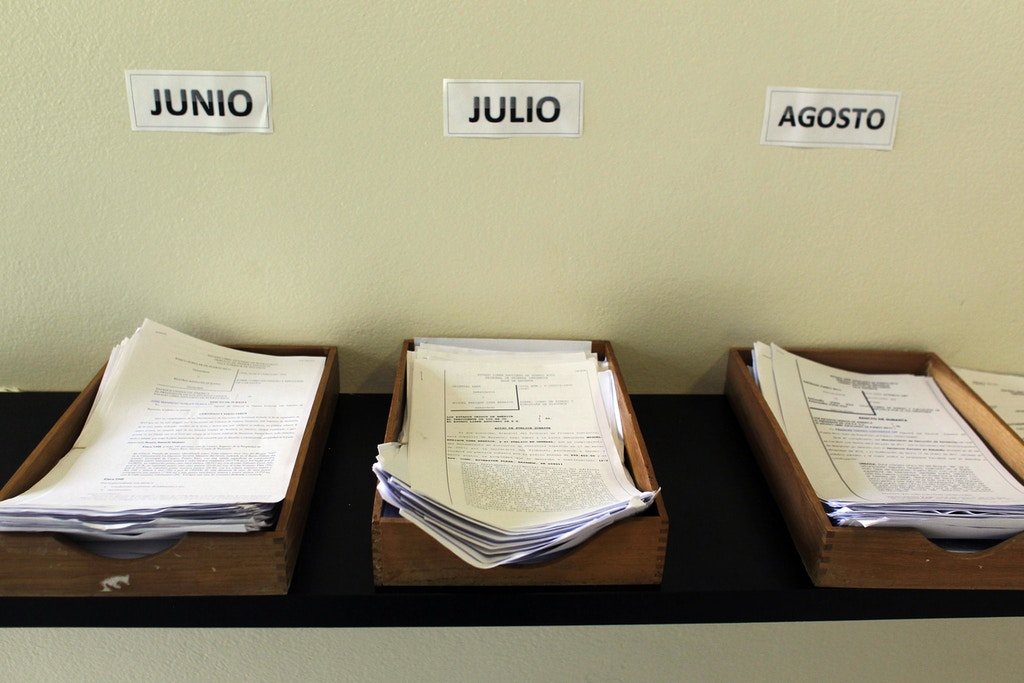 Piles of home foreclosure documents inside wooden paper holders in the court of first instance, in Bayamon Puerto Rico, Tuesday, June 20, 2017. An average of 14 families are losing their homes every day to foreclosure in Puerto Rico, more than double the rate a decade ago as the island faces a real estate crash worse than the one that sparked the great recession on the U.S. mainland. (AP Photo/Ricardo Arduengo)