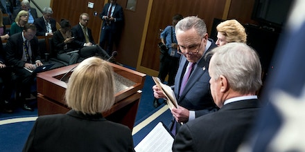 Senate Minority Leader Sen. Chuck Schumer of N.Y., second from left, Sen. Dick Durbin, right, D-Ill., Sen. Patty Murray, D-Wash., left, and Sen. Debbie Stabenow, D-Mich., top right, hold at a news conference on Capitol Hill in Washington, Thursday, Dec. 21, 2017, on a review of the Republican agenda this past year. (AP Photo/Andrew Harnik)