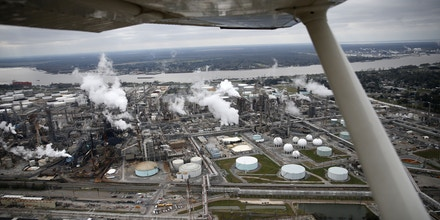 In this aerial photograph about 10 miles upriver from New Orleans, the Shell Norco Manufaturing Complex, an oil refinery, is seen in St. Charles Parish, La., along the Mississippi River, Sunday, Jan. 10, 2016. (AP Photo/Gerald Herbert)