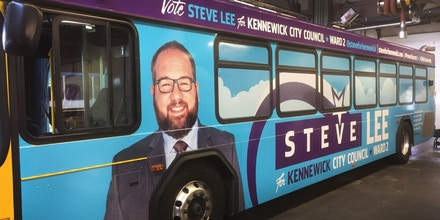 Kennewick City Council candidate Steve Lee's campaign ad on the side of a Ben Franklin Transit bus, the bus system for the state of Washington.