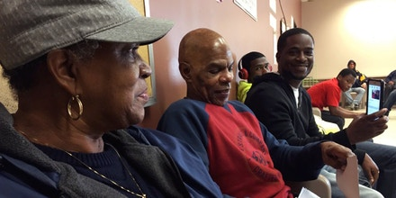 Zerious Meadows, his sister Beverly and two nephews waiting to see his parole officer, in Detroit, MI,  a few hours after he was released on November 14, 2017.