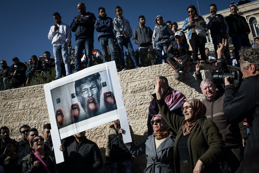 JERUSALEM, ISRAEL - DECEMBER 08:  Palestinians hold a poster of President Trump as they protest outside the Damascus Gate of the Old City after Friday prayer on December 8, 2017 in Jerusalem, Israel. At least 50 Palestinians have been wounded in clashes between Palestinian protestors and Israeli security forces in the West Bank and the Gaza Strip on Friday after thousands of protestors took to the streets in a second 'Day of Rage' following U.S. President Donald Trump's decision to recognize Jerusalem as Israel's capital on Wednesday.  (Photo by Chris McGrath/Getty Images)