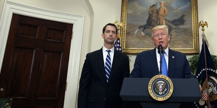 President Donald Trump, accompanied by Sen. Tom Cotton, R- Ark., left, and Sen. David Perdue, R-Ga., speaks in the Roosevelt Room of the White House in Washington, Wednesday, Aug. 2, 2017, during the unveiling of legislation that would place new limits on legal immigration. (AP Photo/Evan Vucci)