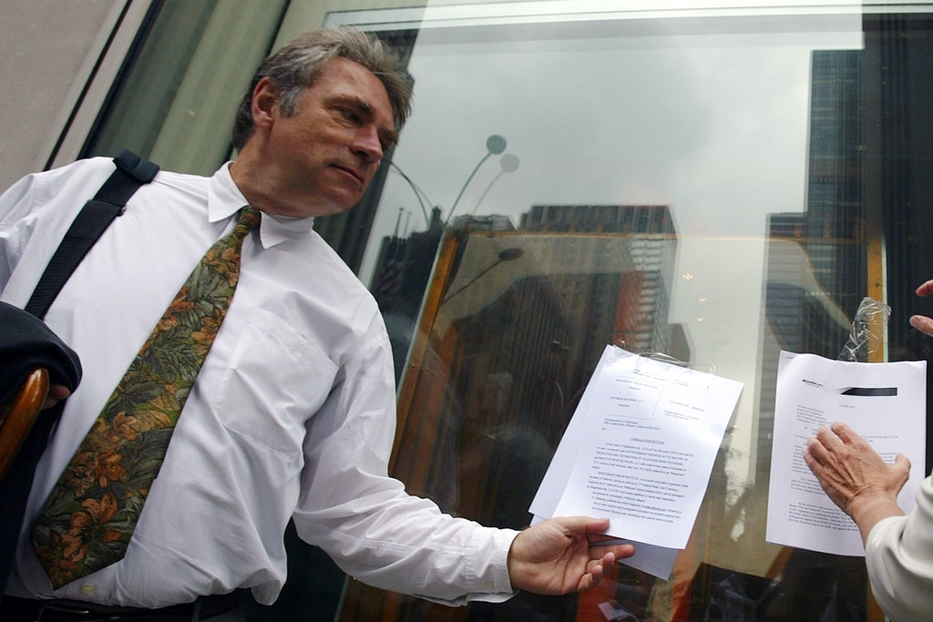 "NEW YORK - JULY 19:  Don Hazen, Executive Editor of AlterNet, (L) and Chellie Pingree, Common Cause President, tape-up a petition against FOX News at FOXs' headquarters July 19, 2004 in New York for its use of the tagline ""fair and balanced"". The petition, which was filed with the Federal Trade Commission (FTC) by MoveOn.org and Common Cause, argues that FOX News displays a blatant Republican bias in its coverage and should therefore be stopped from using the term ""fair and balanced"". The petition argues that the use of the term violates section 5 of the Federal Trade Commission Act for deceptive practices in advertising and marketing.  (Photo by Spencer Platt/Getty Images)"