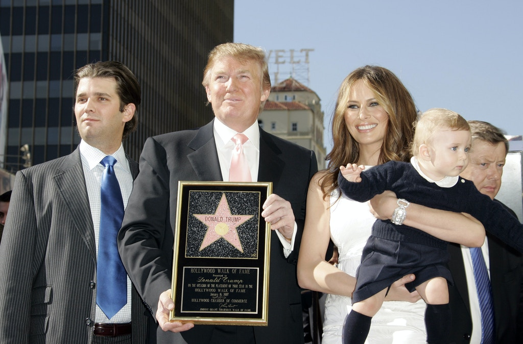 Donald Trump Jr., Donald Trump, Melania Trump and baby Barron Trump (Photo by Jean Baptiste Lacroix/WireImage)