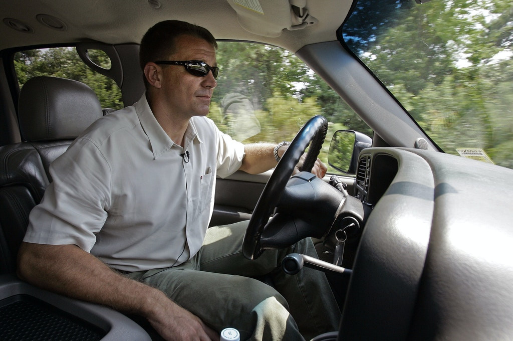 Erik Prince, Founder and CEO of Blackwater Worldwide drives through campus in Moyock, N.C., Monday, July 21, 2008. Prince, along with another former Navy SEAL, turned to the swamps of eastern North Carolina, where he could train SEALS based at Virginia Beach and build a business among law enforcement and military, believing all lacked a one-stop training site. (AP Photo/Gerry Broome)