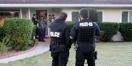 Members of the immigrant removal task force of the Immigration and Customs Enforcement (ICE) outside a home, during an early morning raid to arrest and deport and immigrant. This ICE team is one of 14 throughout Southern California that focuses exclusively on arresting and deporting immigrants with deportation notices. (Photo by J. Emilio Flores/Corbis via Getty Images)