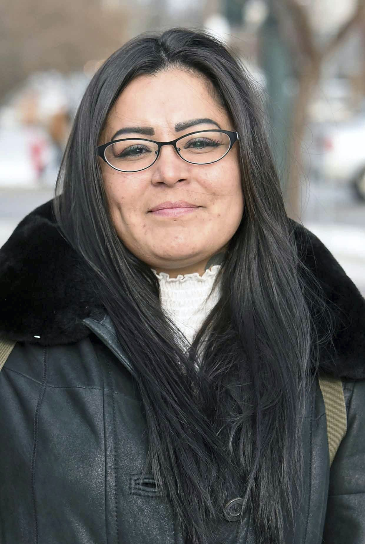 Red Fawn Fallis smiles outside the Federal Courthouse in Bismarck, N.D., on Friday, Dec. 8, 2017. Fallis was in court for a hearing on charges related to protests against the Dakota Access Pipeline. (Tom Stromme /The Bismarck Tribune via AP)