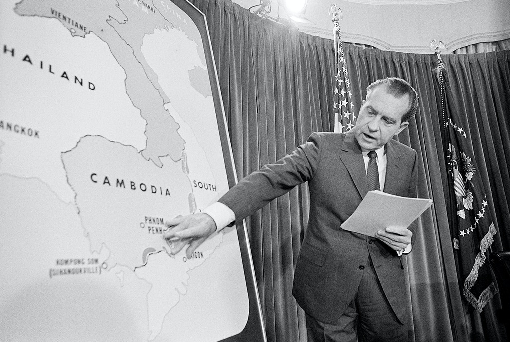 (Original Caption) 4/30/1970-Washington, DC-In a TV speech to the nation from the White House, President Nixon announced that several thousand American ground troops have entered Cambodia to wipe out Communist headquarters for all military operations against South Vietnam. The president is shown here pointing to a map of Cambodia.