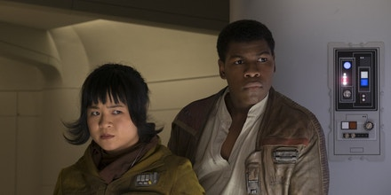 Star Wars: The Last Jedi..L to R: Rose (Kelly Marie Tran) and Finn (John Boyega)..Photo: David James..©2017 Lucasfilm Ltd. All Rights Reserved.