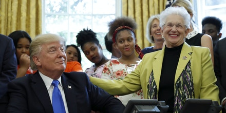 President Donald Trump reacts with Rep. Virginia Foxx, R-N.C., before signing a memorandum to expand access to STEM, science technology engineering and math, education, in the Oval Office of the White House, Monday, Sept. 25, 2017, in Washington. (AP Photo/Alex Brandon)