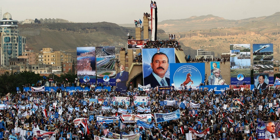 TOPSHOT - Hundreds of thousands of Yemenis hold posters and portraits of Yemen's ex-president Ali Abdullah Saleh during a demonstration in support of the former president, as his political party marks 35 years since its founding, at Sabaeen Square in the capital Sanaa on August 24, 2017. The rally comes amid reports that armed supporters of Saleh and the head of the country's Huthi rebels, who have been allied against the Saudi-backed government since 2014, had spread throughout the capital as tensions are rising between the two sides. / AFP PHOTO / MOHAMMED HUWAIS (Photo credit should read MOHAMMED HUWAIS/AFP/Getty Images)