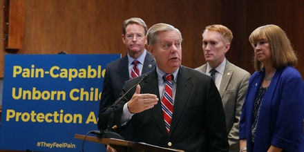 WASHINGTON, DC - OCTOBER 05:  Sen. Lindsey Graham (R-SC) introduces the Senate version of the 'Pain Capable Unborn Child Protection Act' with (L-R) Family Research Council President Tony Perkins, Sen. James Lankford (R-OK), National Right to Life President Carol Tobias other representatives from anti-abortion groups during a news conference in the Dirksen Senate Office Building on Capitol Hill October 5, 2017 in Washington, DC. Graham's bill is the companion legislation to House of Representatives' version, which passed earlier this week by a vote of 237 to 189.  (Photo by Chip Somodevilla/Getty Images)