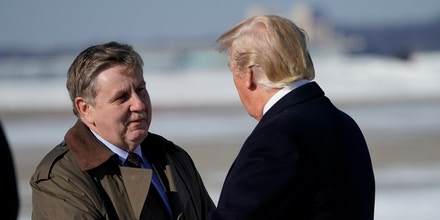 Congressional candidate Rick Saccone (L) greets US President Donald Trump upon arrival at Pittsburgh International Airport in Pittsburgh, Pennsylvania on January 18, 2018. / AFP PHOTO / MANDEL NGAN        (Photo credit should read MANDEL NGAN/AFP/Getty Images)