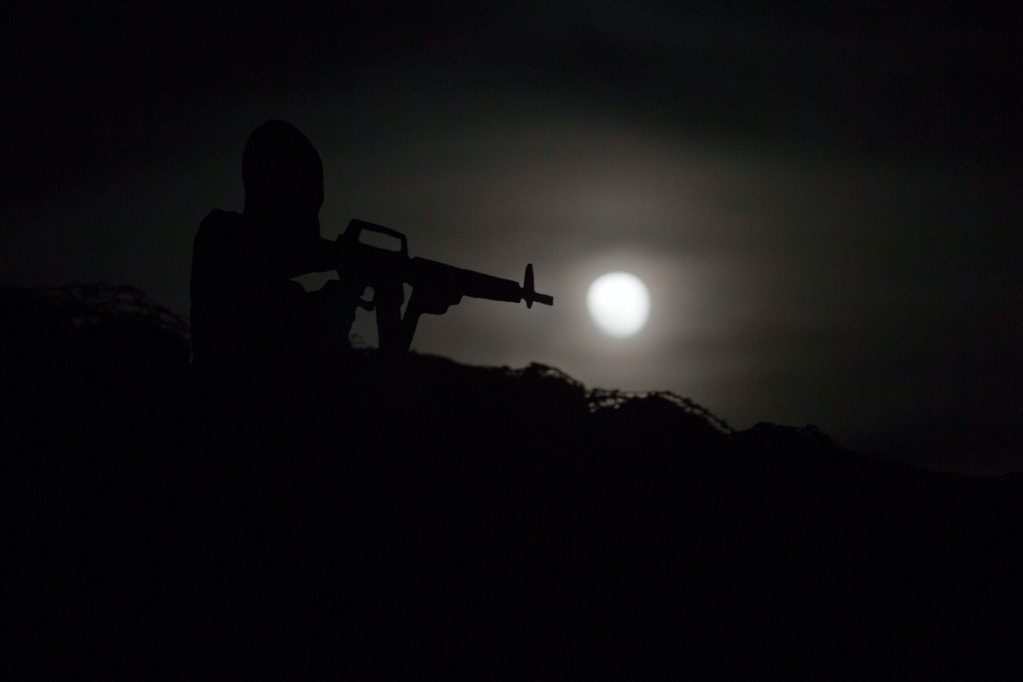 "A metal placard in the shape of an Israeli soldier stands on an old bunker as the moon rises over Syria as seen from the Israeli controlled Golan Heights, Monday, Nov. 14, 2016. The brightest moon in almost 69 years lit up the sky, during its closest approach to earth as the ""Supermoon"" reached its most luminescent phase. The moon won't be this close again until Nov. 25, 2035. (AP Photo/Ariel Schalit)"