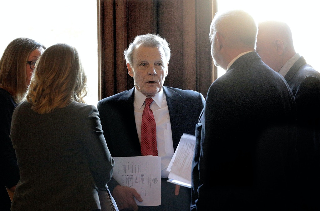 Illinois Speaker of the House Michael Madigan, D-Chicago, center, talks with his staff inside Illinois Gov. Bruce Rauner's office during veto session at the Illinois State Capitol Wednesday, Nov. 16, 2016, in Springfield, Ill. (AP Photo/Seth Perlman)