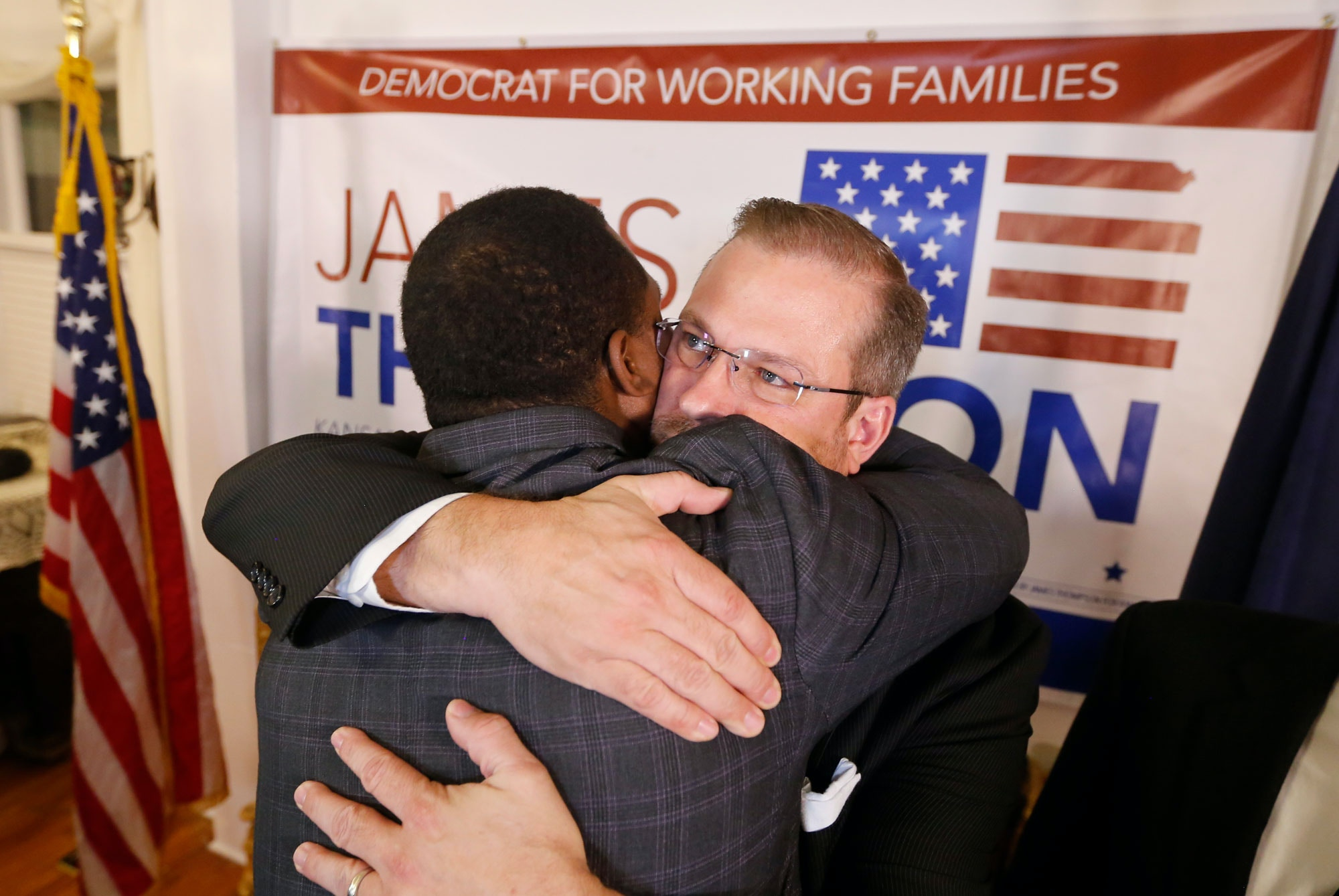 Democrat James Thompson gets a hug from supporter Djuan Wash at the Murdock Theatre in Wichita, Kan., Tuesday, April, 11, 2017. Thompson came up short in his bid to beat republican Ron Estes in a special election to replace current CIA director, and former U.S. Rep Mike Pompeo in the Kansas 4th congressional district. (Travis Heying/The Wichita Eagle via AP)