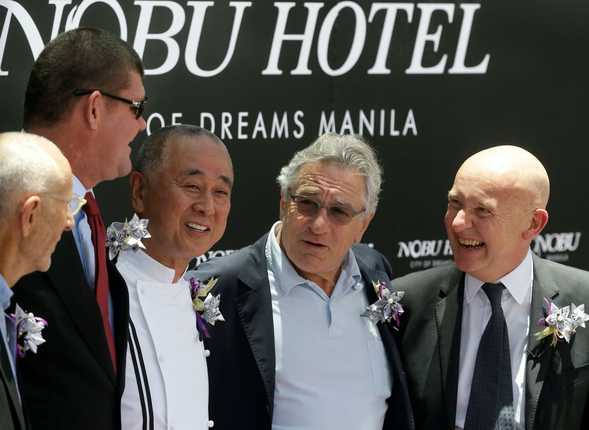 Trevor Horwell, CEO of Nobu Hospitality, from right,  Hollywood actor Robert De Niro, Japanese culinary Chef Nobu Matsuhisa, Melco Crown Entertainment Co-Chair James Packer and Hollywood film producer Meir Teper pose during the  ribbon-cutting ceremony at the opening of the Nobu Hotel at the City of Dreams Casino Monday, May 18, 2015 at suburban Pasay city, south of Manila, Philippines. The 321-room Nobu Hotel, founded by partners Chef Nobu, Robert De Niro and Teper, is said to be the first Nobu hotel to open in Asia. (AP Photo/Bullit Marquez)