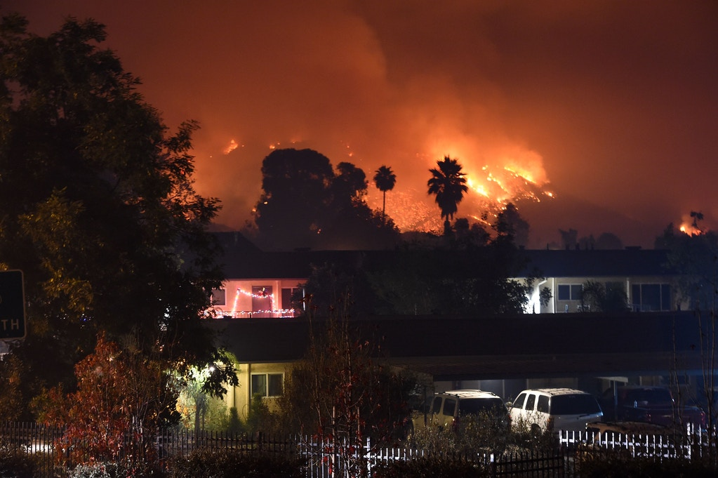 Flames from the Thomas Fire burn in the hills above Carpinteria, California, December 11, 2017.The Thomas Fire in California's Ventura and Santa Barbara counties has consumed more than 230,000 acres over the past week making it the fifth largest fire in the state's history. / AFP PHOTO / Robyn Beck (Photo credit should read ROBYN BECK/AFP/Getty Images)