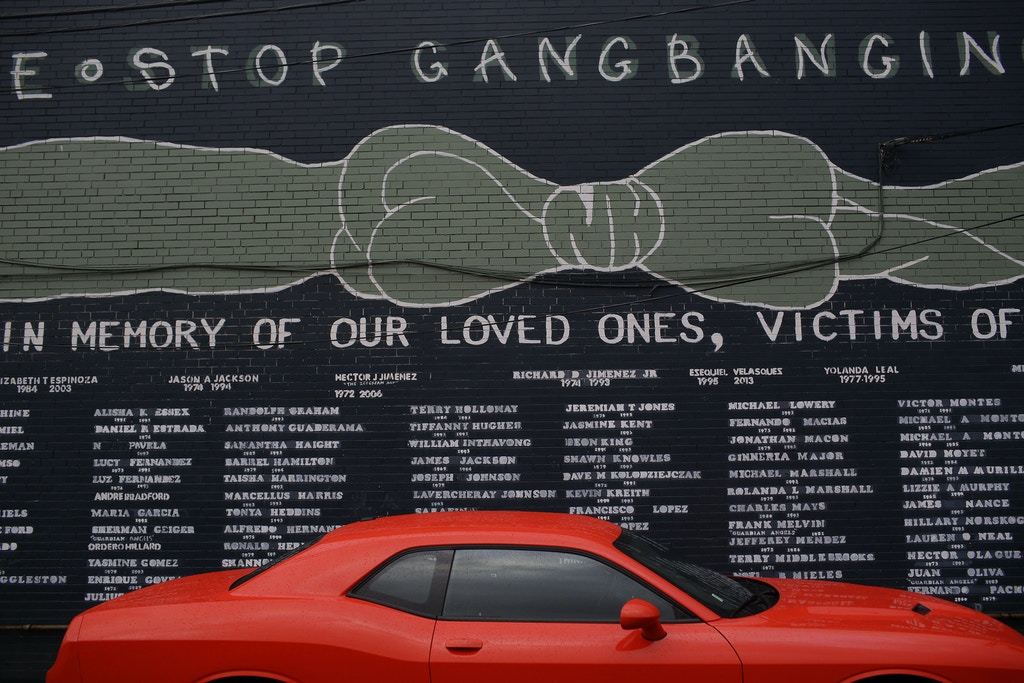 The names of victims of violence is displayed on a wall along 47th Street in the Back of the Yards neighborhood Thursday, January 11, 2018 in Chicago, Illinois.