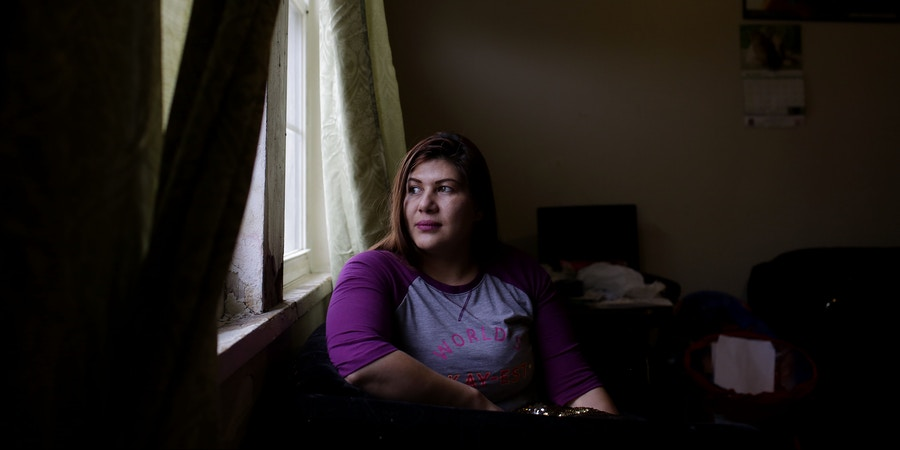 Celene Adame poses for a portrait at her home Wednesday, January 10, 2018 in Chicago, Illinois. Adame's husband Wilmer Catalan-Ramirez was arrested by U.S. Immigration and Customs Enforcement after they showed up at his home last year in March. Catalan-Ramirez  has been separated from his family and detained since his arrest. Photo by Joshua Lott for The Intercept