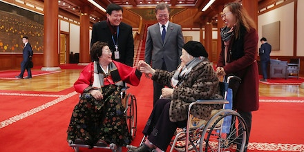 SEOUL, SOUTH KOREA - JANUARY 04:  In this handout photo released by the South Korean Presidential Blue House, South Korean President Moon Jae-in meets 'comfort women', former South Korean sex slaves at the Presidential Blue House on January 4, 2018 in Seoul, South Korea.  (Photo by South Korean Presidential Blue House via Getty Images)