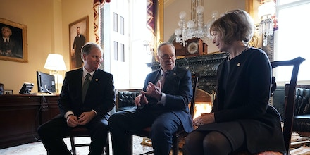 WASHINGTON, DC - JANUARY 03:  U.S. Senate Minority Leader Sen. Chuck Schumer (D-NY) (C) speaks to Sen. Doug Jones (D-AL) (L) and Sen. Tina Smith (D-MN) during a meeting at the U.S. Capitol January 3, 2018 in Washington, DC. Schumer held a meeting with the two newly sworn-in Democratic Senators in his office.  (Photo by Alex Wong/Getty Images)