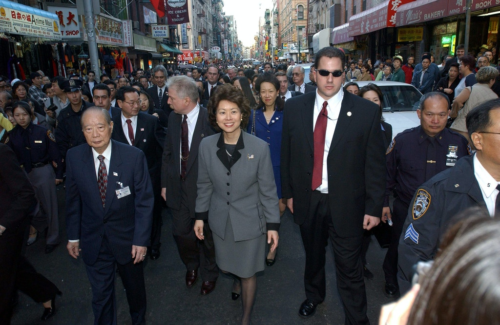 398010 06: Secretary of Labor Elaine L. Chao walks in a parade December 1, 2001 in the Chinatown section of New York City. Chao announced today that the U.S. Department of Labor and the New York State Department of Labor have agreed to target $1 million in National Emergency Grant funds to aid dislocated workers in Chinatown who were impacted by the September 11 terrorist attacks. (Photo by Darren McCollester/Getty Images)