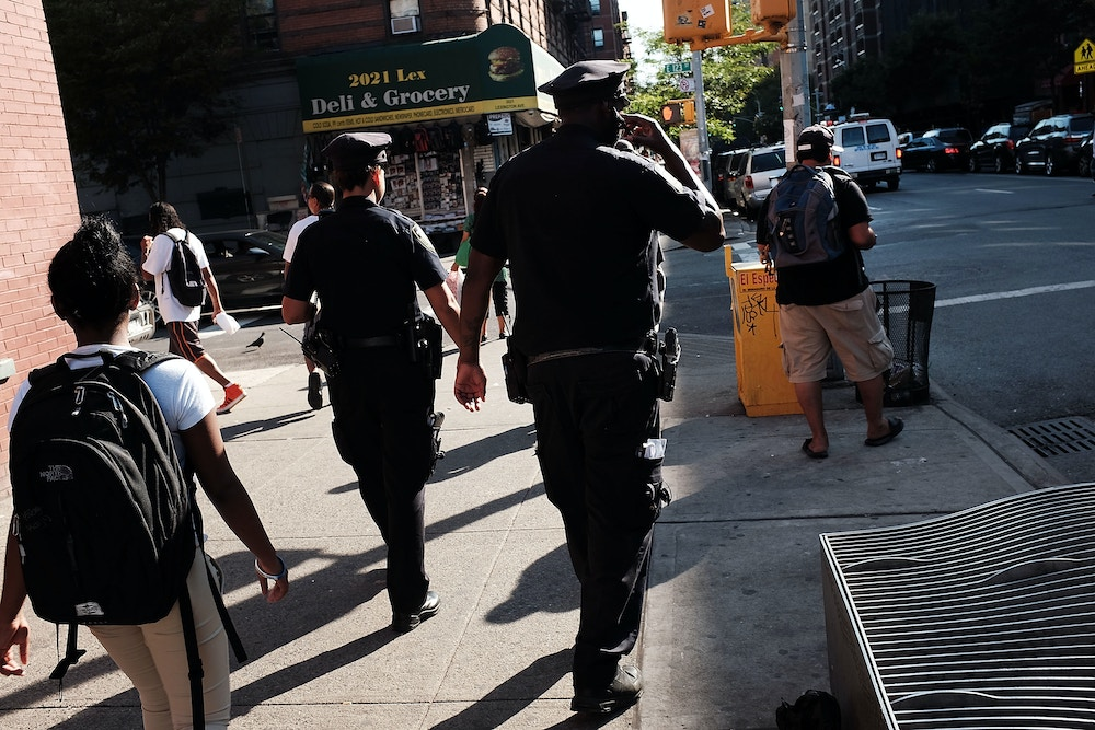 NEW YORK, NY - SEPTEMBER 16:  Police are viewed in an area which has witnessed an explosion in the use of K2 or 'Spice', a synthetic marijuana drug, in East Harlem on September 16, 2015 in New York City.  In a a news conference today with William Bratton, the police commissioner and Preet Bharara, the United States attorney for the Southern District of New York, it was announced that the Federal and New York City authorities have broken up a group that trafficked in synthetic marijuana. New York, along with other cities, is experiencing a deadly epidemic of synthetic marijuana usage which can cause extreme reactions in some users. According to New York's health department, more than 120 people visited an emergency room in the city in just one week in April.  (Photo by Spencer Platt/Getty Images)