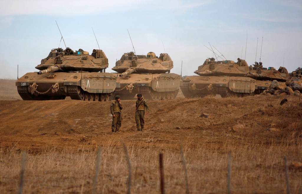 A picture taken on November 20, 2017 shows Israeli Merkava Mk-IV tanks taking part in a military exercise near the border with Syria in the Israeli-occupied Golan Heights. / AFP PHOTO / JALAA MAREY        (Photo credit should read JALAA MAREY/AFP/Getty Images)