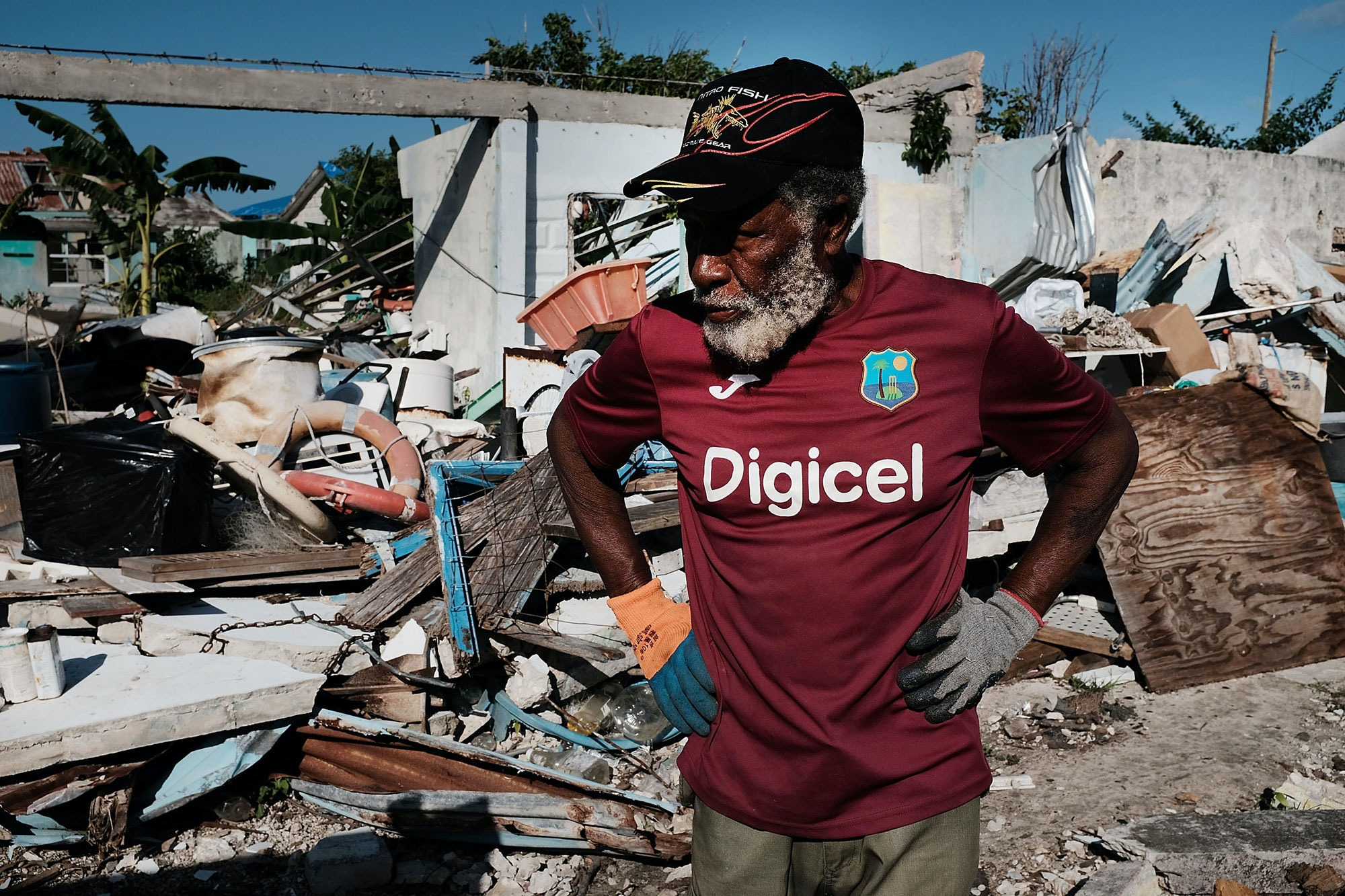 CODRINGTON, BARBUDA - DECEMBER 08: Sherwan Webber stands amongst the debris of his home on the nearly destroyed island of Barbuda on December 8, 2017 in Cordington, Barbuda. Barbuda, which covers only 62 square miles, was nearly leveled when Hurricane Irma made landfall with 185mph winds on the night of  September six. Only two days later, fearing Barbuda would be hit again by Hurricane Jose, the prime minister ordered an evacuation of all 1,800 residents of the island. Most are now still in shelters scattered  around Barbuda's much larger sister island Antigua.  (Photo by Spencer Platt/Getty Images)