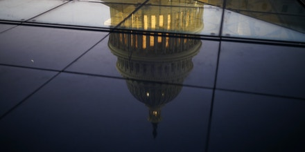 WASHINGTON, DC - JANUARY 19: The U.S. Capitol is seen reflected in the windows of the Capitol Visitors Center as lawmakers work to avert a government shutdown January 19, 2018 in Washington, DC. A continuing resolution to fund the government has passed the House of Representatives but faces a stiff challenge in the Senate. (Photo by Aaron P. Bernstein/Getty Images)