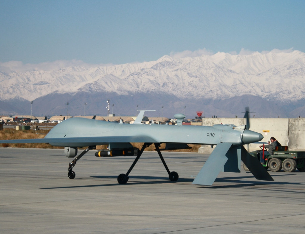 A US Predator unmanned drone armed with a missile sets off from its hangar at Bagram air base on November 27, 2009. AFP PHOTO/BONNY SCHOONAKKER (Photo credit should read Bonny Schoonakker/AFP/Getty Images)