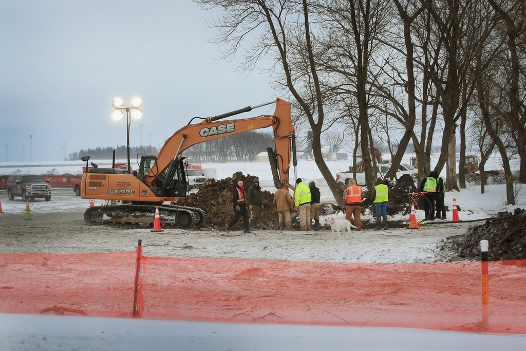 "HANLONTOWN, IA - JANUARY 29:  Crews continue  cleanup efforts after a 12"" underground pipeline ruptured spilling nearly 140,000 gallons of diesel fuel onto a farm on January 29, 2017 near Hanlontown, Iowa. The leak in the pipeline, which is owned by Magellan Midstream Partners, was discovered on January 25. The cause is still under investigation.  (Photo by Scott Olson/Getty Images)"