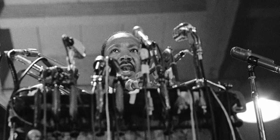 Dr. Martin Luther King, head of the Southern Christian Leadership Conference, delivers his speech that opened The National Conference for New Politico Convention in Chicago, Sept. 1, 1967. King, facing a battery of microphones, called for an end of the Vietnam fighting. (AP Photo/Charles Harrity)