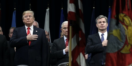 President Donald Trump, Attorney General Jeff Sessions, center and FBI Director Christopher Wray stand during the National Anthem at the FBI National Academy graduation ceremony, Friday, Dec. 15, 2017, in Quantico, Va.   The White House says newly revealed FBI records show there is